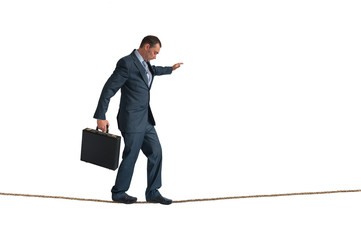 isolated businessman balancing tightrope