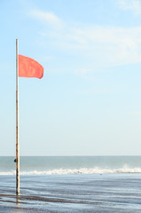View of Storm Seascape and Red Flag