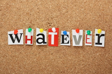The word Whatever on a cork notice board