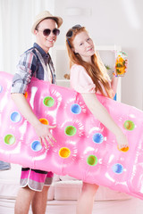 Young couple with inflatable mattress