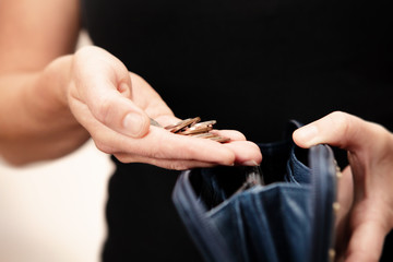 woman holding money over purse