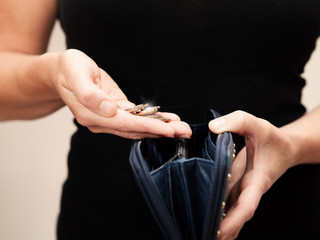 woman with coins and purse