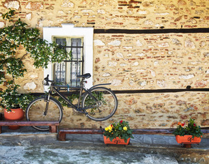 Black  bicycle against old house wall