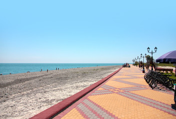 varicoloured road for pedestrian and marine beach