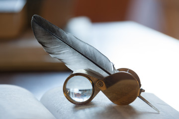 open book and quill pen