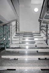 metallic brilliant rails and stage marble stair