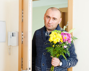 man with    flowers near  door