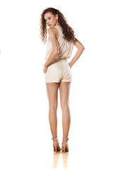 rear view of young model in shorts on white background