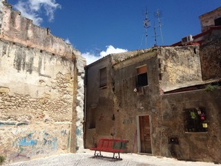 lonely red bench at sassari