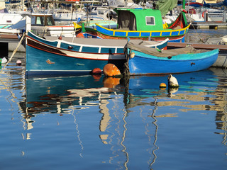 Colourful painted fishing boats in Msida creek harbour, Malta