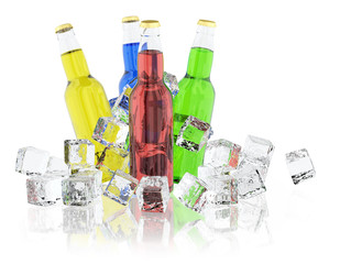 Bottles with colored drinks and ice cubes