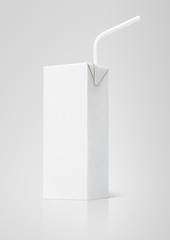 200 ml milk or juice white carton package with straw on gray
