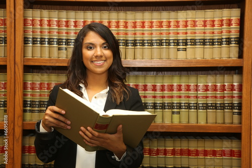 Female law student in law library - 66958118