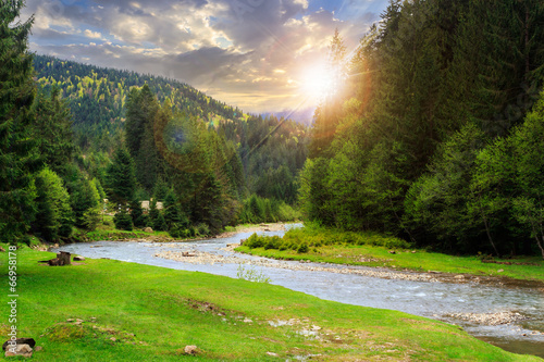 canvas print picture camping place near mountain river at sunset