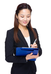 Business woman write something on file pad