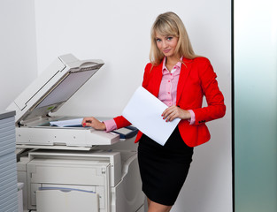 business woman working on office printer