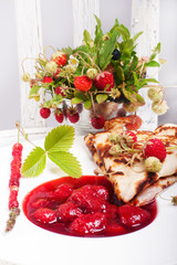 Pancakes with fresh strawberries and jam