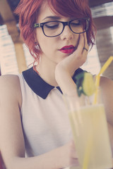 Cute hipster teenage girl daydreaming, retro colors