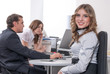 Young business lady smiling in office