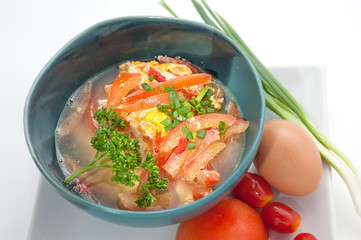 Asian traditional soup with tomato and egg