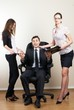 Businessman with assistants