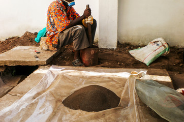 Koltan,Coltan, a Congolese grounding coltan ore in a background