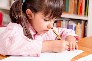Little girl learning to write