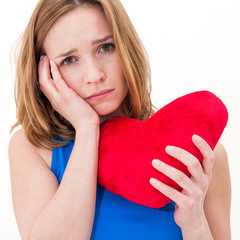 lonely sad woman holding red valentine heart