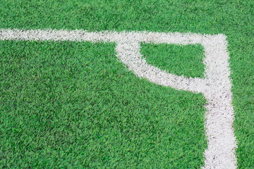 Green Grass texture of soccer or football field corner