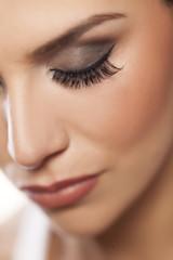 female eye with long false eyelashes