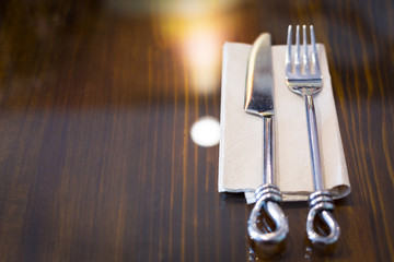 Fork and knife on empty table with copyspace