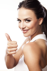 beautiful young woman showing thumbs up