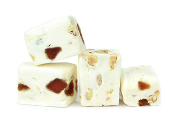 Soft nougat with peanuts and fruits on a white background