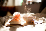 Book and tea in bed morning met - 66962986