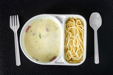 spaghetti carbonara with ham in the package