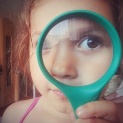 Cute kid using magnifying glass