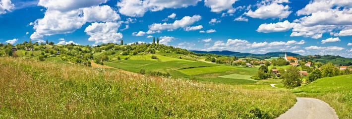 Idyllic green landscape and village