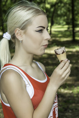 Pretty young female eating ice cream