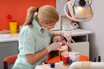 Dental procedure, female dentist examine tooth