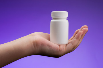Supplements, medications or vitamin bottle
