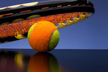 Tennis ball for children with tennis racket