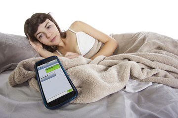 female receiving text messages before going to bed