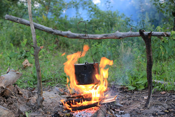 smoked kettle on camp fire