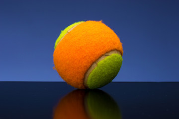 Tennis ball for children with tennis racket