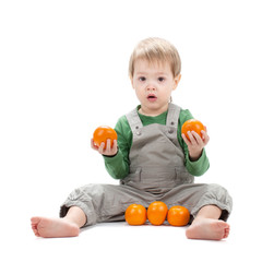 Baby with oranges