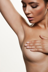 Young woman doing a breast self-examination