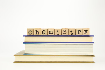chemistry word on wood stamps and books