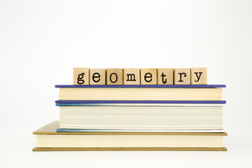 geometry word on wood stamps and books