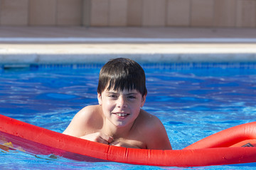 Young boy in a swimming pool