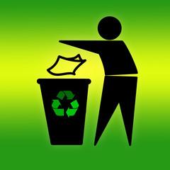 Throwing waste in recycling bin on green